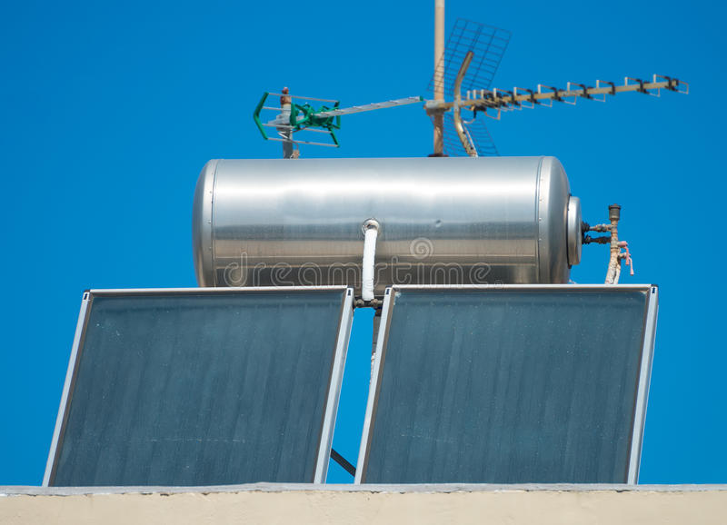 Solar water heating system. Solar water heating system on the rooftops stock image