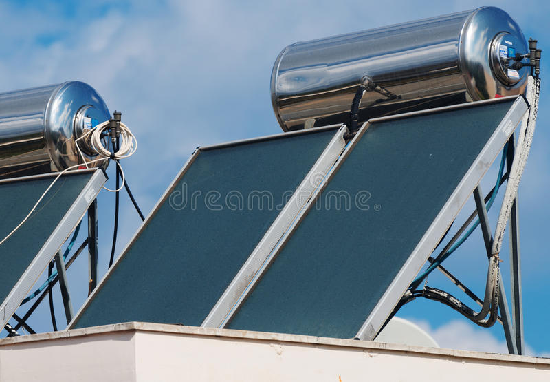 Solar water heating system. Solar water heating system on the rooftops royalty free stock images