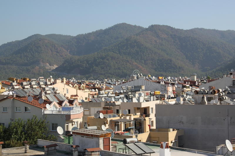 Solar water heating systems on the roofs of the city of Marmaris, Turkey royalty free stock images