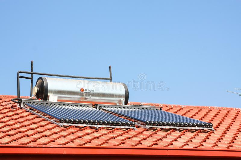 Solar Water Heating Tubes on a roof. Johannesburg, South Africa - August 28 2010: Solar Water Heating Tubes on a roof royalty free stock images
