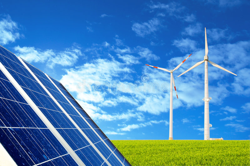 Solar and wind energy. Solar panel and wind to produce energy royalty free stock images