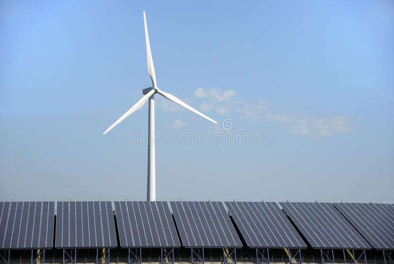Solar and wind energy plant. Solar cells and power wind mill in Holland stock photo