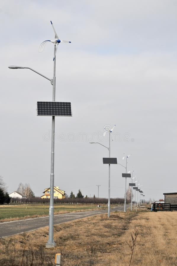 Solar and wind energy. This is a view of lamps powered by solar and wind energy royalty free stock images