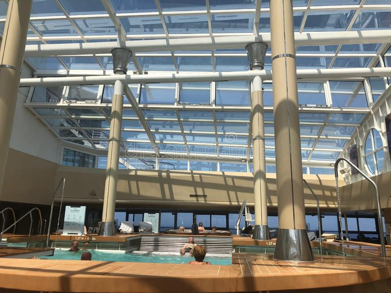 The Solarium, indoor pool onboard cruise ship. stock photos