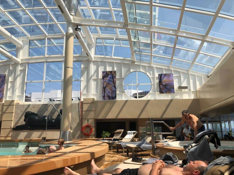 The Solarium, indoor pool onboard cruise ship. stock photo