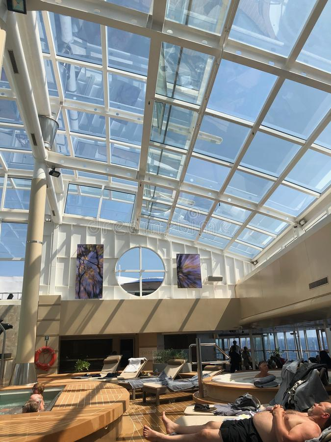 The Solarium, indoor pool onboard cruise ship. royalty free stock photography