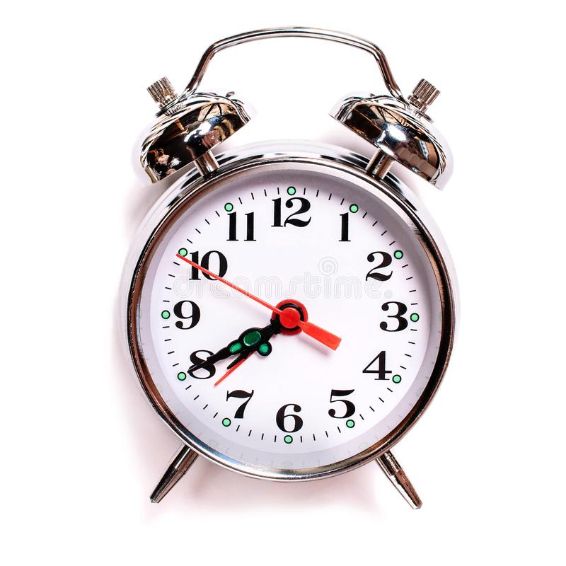 Solated vintage analog alarm clock on a white background. Seven forty am on alarm clock stock photos