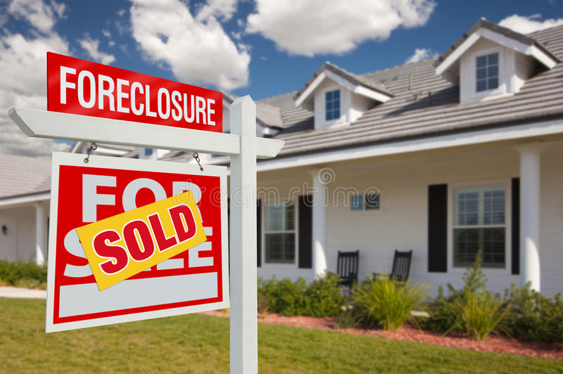 Sold Foreclosure Real Estate Sign and House - Left. Sold Foreclosure Home For Sale Real Estate Sign in Front of New House - Left Facing stock photography