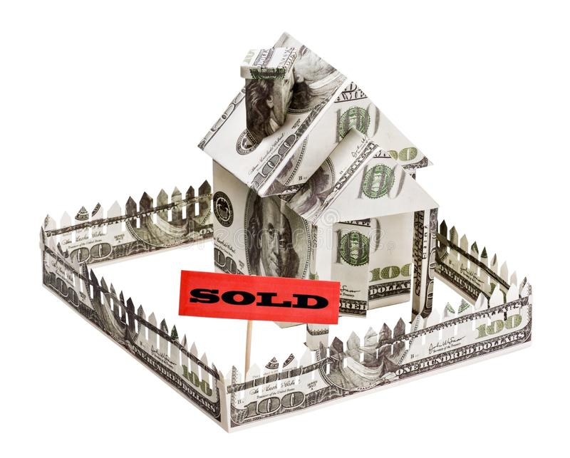 Sold a house made of money. Isolated on white background royalty free stock images