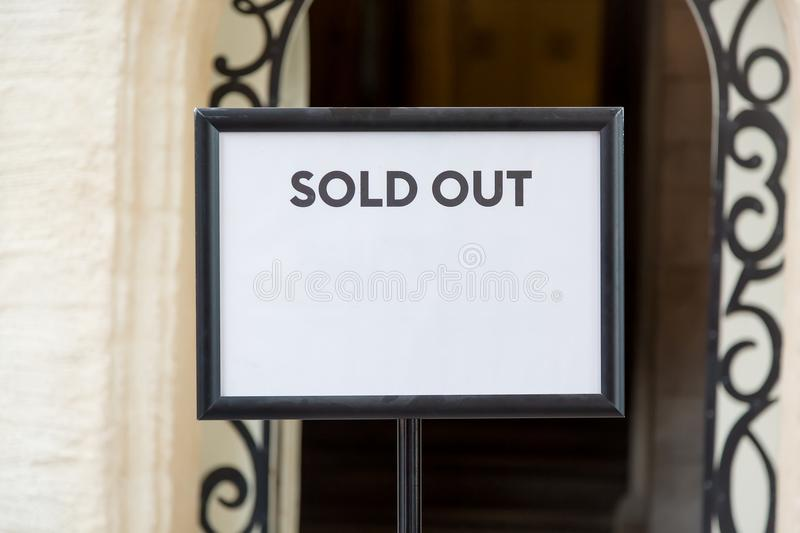 Sold out real estate or tickets sign before the entrance. Free space for your text. royalty free stock images