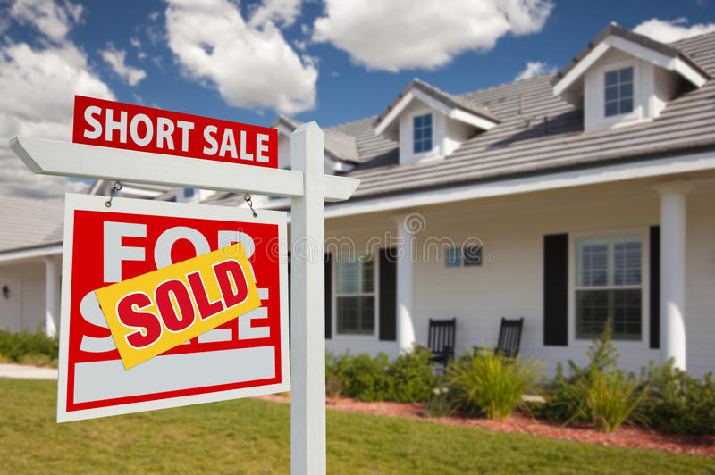 Sold Short Sale Real Estate Sign And House - Left Stock Photo