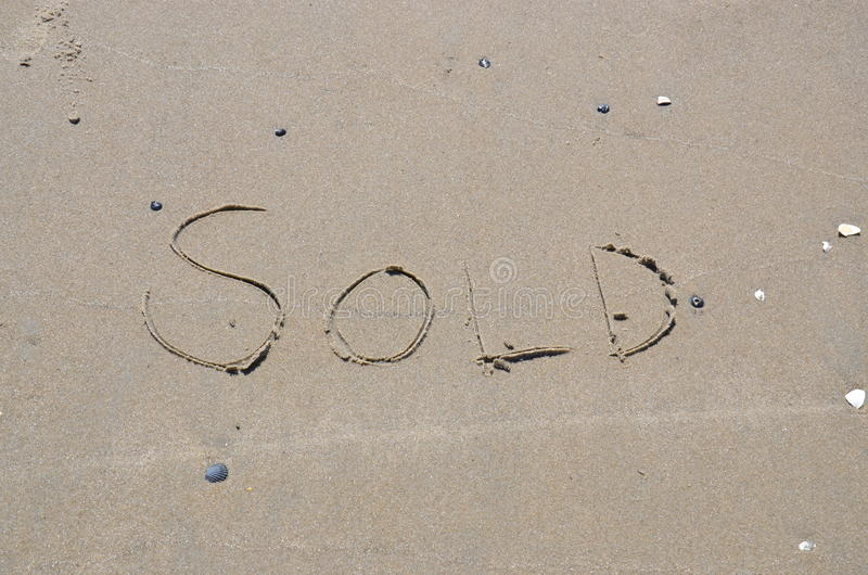 Download Sold Written In The Sand On The Beach Stock Photo - Image: 33955642
