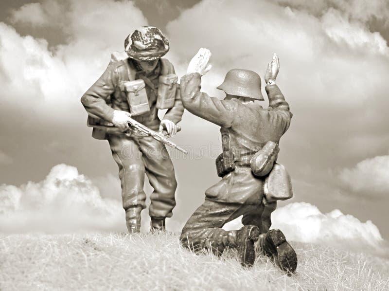 Soldado británico victorioso y nazi caido imagen de archivo