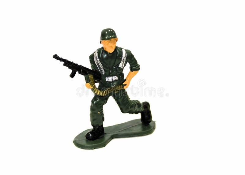 Soldado de brinquedo diminuto no fundo branco, close-up imagens de stock royalty free