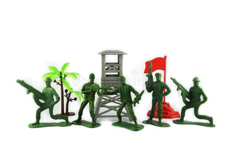 Soldados de brinquedo e base militar imagens de stock