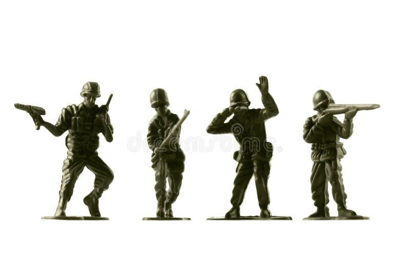 Soldados de brinquedo, isolados no fundo branco fotografia de stock royalty free