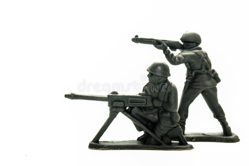 Soldados de brinquedo sobre o branco imagem de stock royalty free