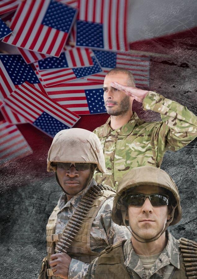 soldados del día de veteranos delante de la bandera fotografía de archivo
