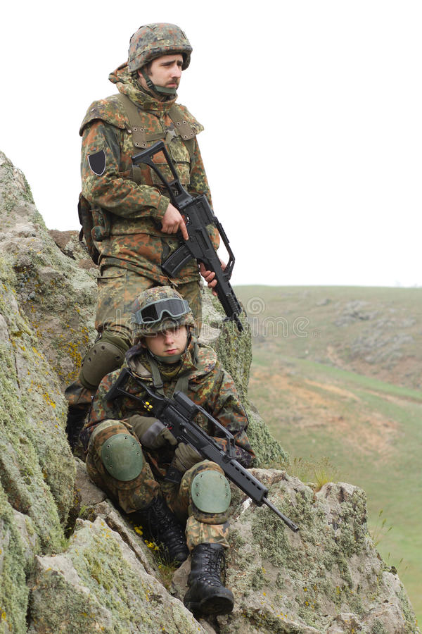 Soldados en la munición pesada del combate fotografía de archivo