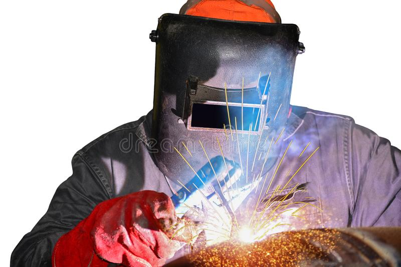 Soldadura del trabajador con la luz de la chispa por la soldadura del arco imagen de archivo libre de regalías