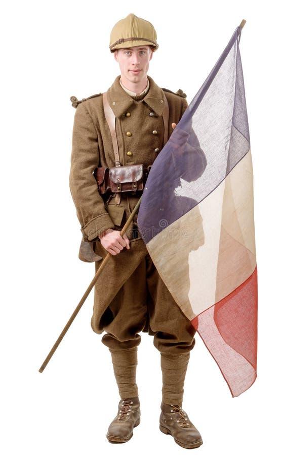soldat de 1940 Français avec un drapeau d'isolement sur un fond blanc photographie stock