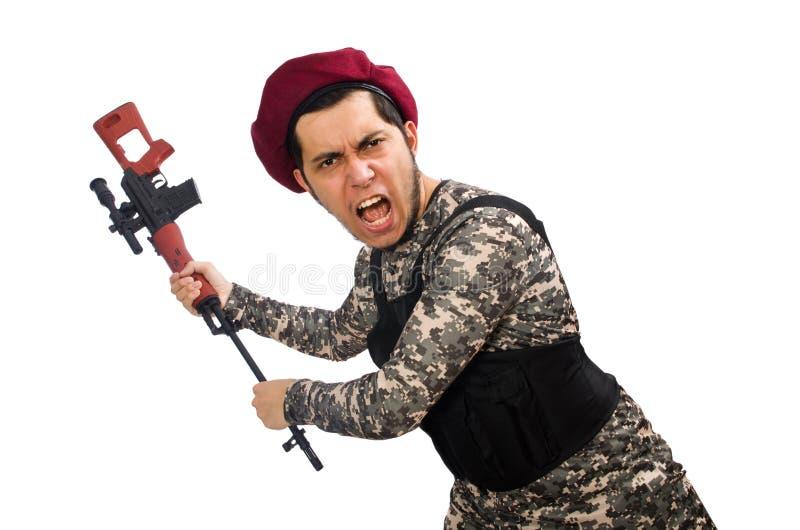Soldat med ett vapen som isoleras på vit arkivfoton