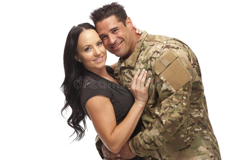 Soldat med hans fru mot vit arkivbild