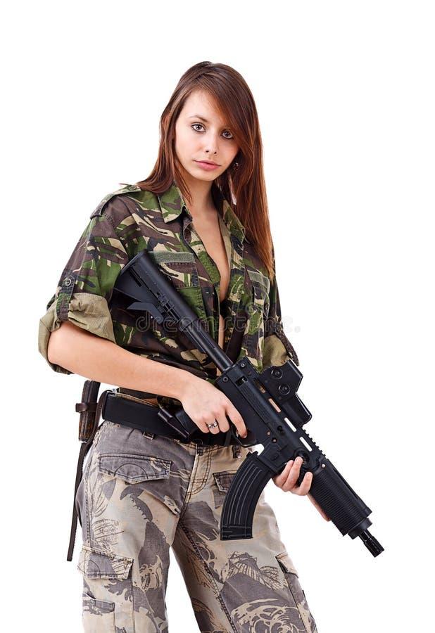 Soldati della giovane donna con le pistole immagini stock libere da diritti
