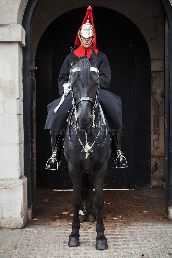 Soldato di cavalleria della cavalleria della famiglia, Londra immagini stock
