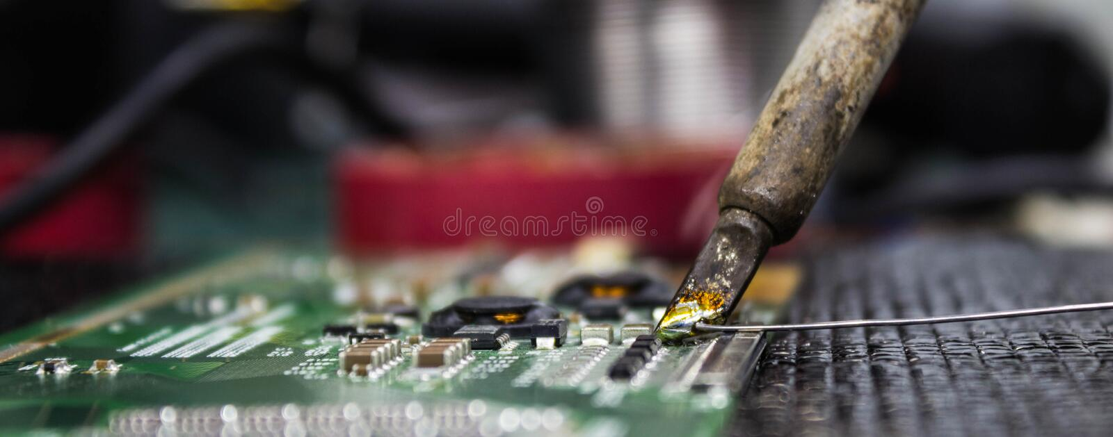 Solder. Ing mainboard repair electronic devices and electronic royalty free stock photos