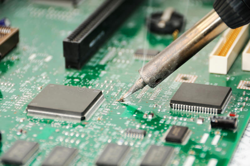 Soldering Iron And Circuit Board Royalty Free Stock Photo