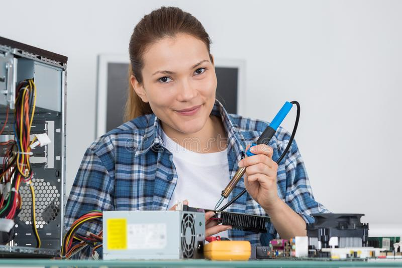 Soldering iron electronic printed board stock photo