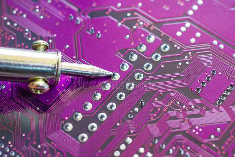 Soldering iron for repairing electronic of the computer circuit board royalty free stock images