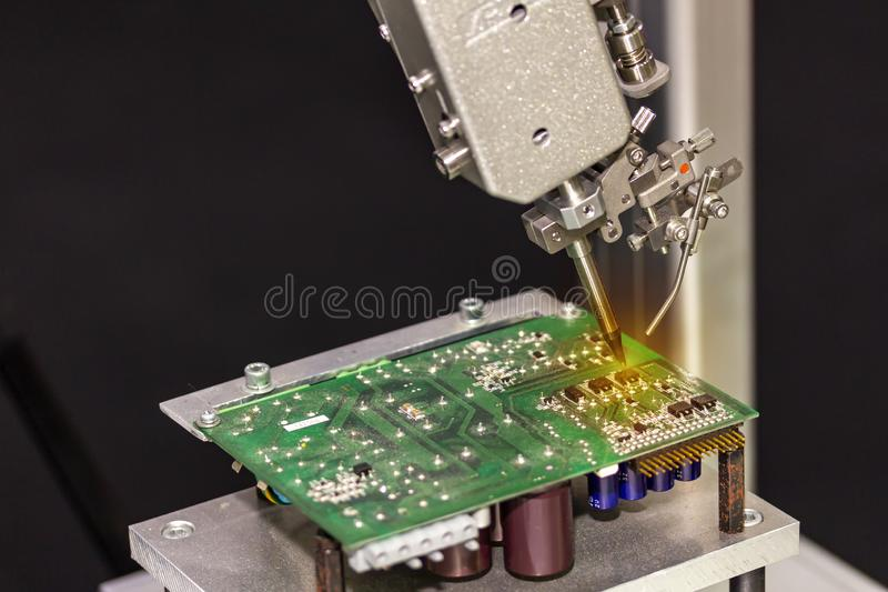 Soldering iron tips of automated manufacturing soldering and assembly printed electric circuit board PCB.  royalty free stock photo