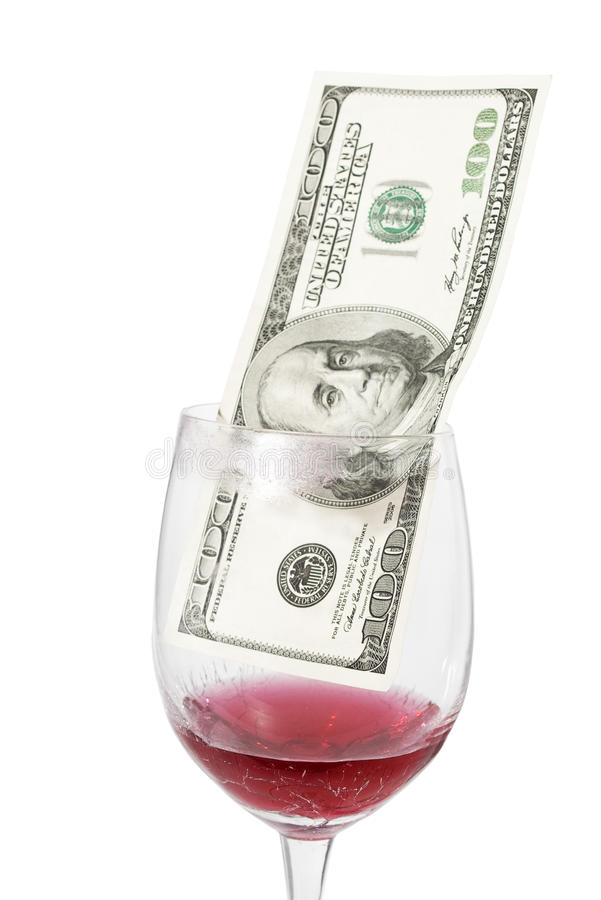 Soldi all'interno del vetro di vino immagini stock