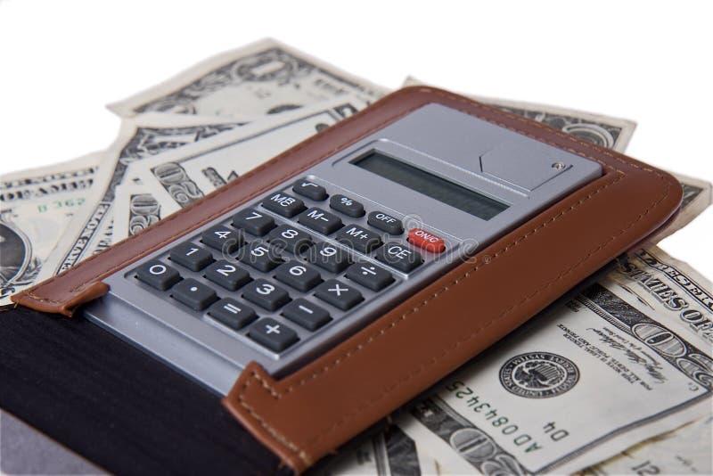 Soldi americani con il blocchetto per appunti ed il calcolatore immagine stock