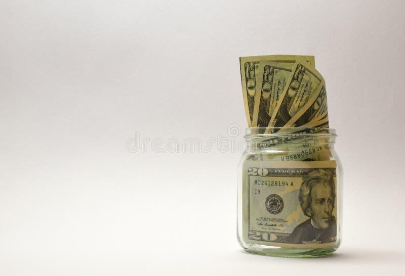 Soldi degli Stati Uniti o valuta o dollari in barattolo di vetro fotografia stock libera da diritti