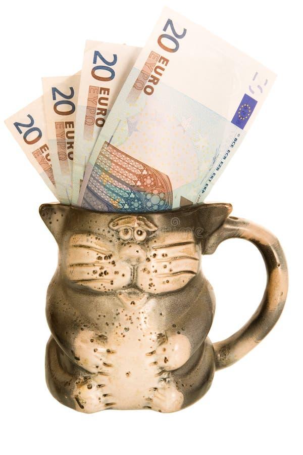 Soldi dell'euro della tazza immagine stock