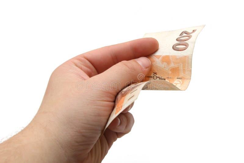 Soldi della banconota del Ceco duecento in una mano fotografia stock