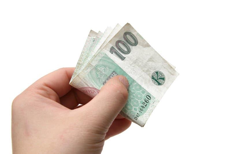 Soldi delle banconote del Ceco cento in una mano fotografia stock libera da diritti