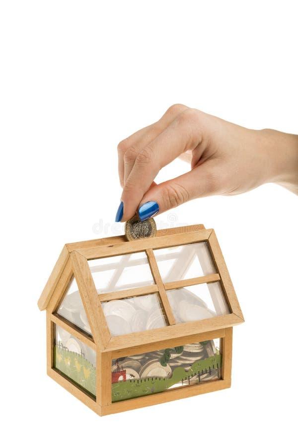 Soldi di risparmio per avere una casa immagine stock