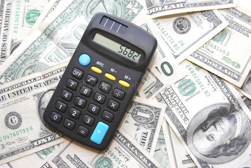 Soldi e calcolatore fotografia stock libera da diritti