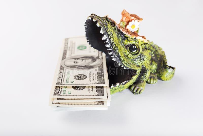 Soldi nella bocca del coccodrillo, dollari americani, USD fotografie stock