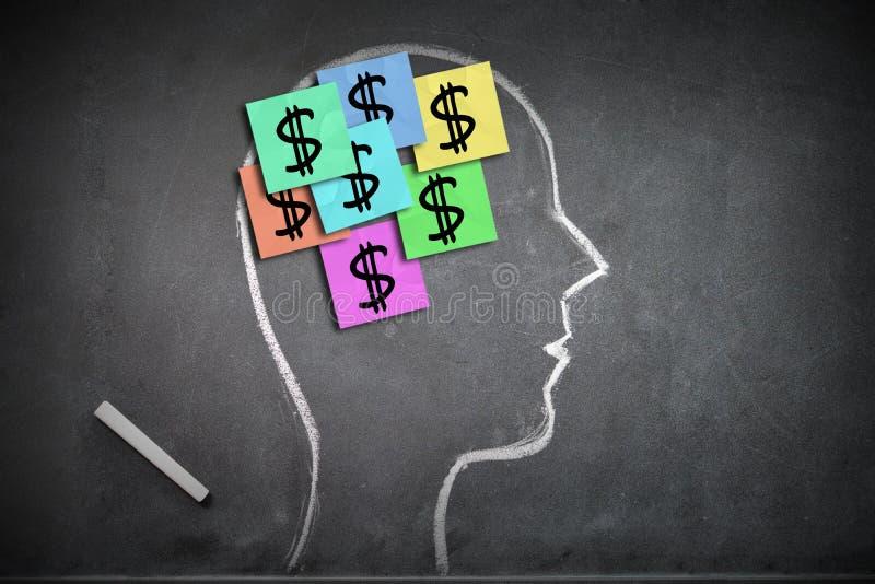 Soldi sul mio concetto di mente con forma della testa umana immagine stock libera da diritti