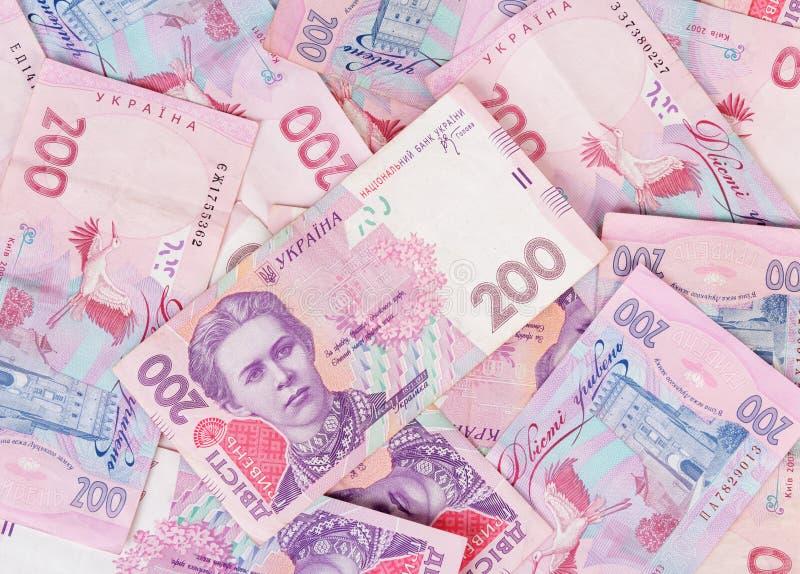 Soldi ucraini del mucchio nella denominazione 200 UAH Fondo fotografie stock