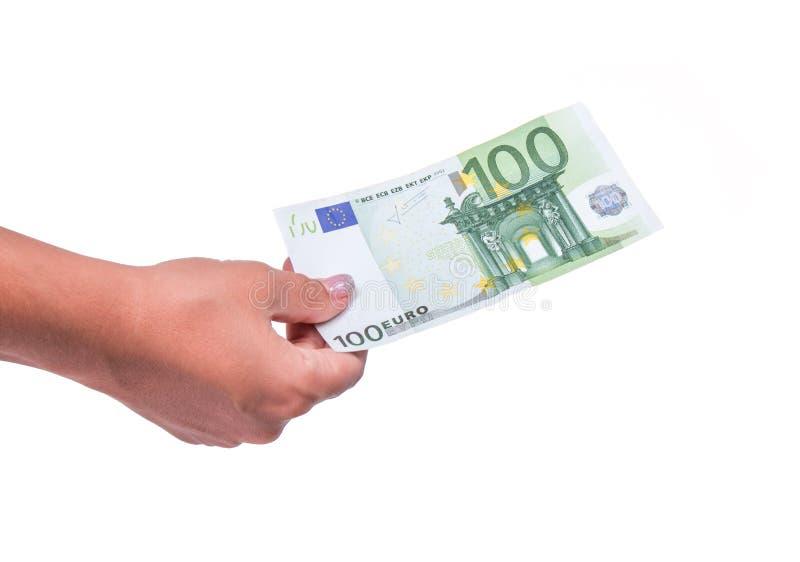 Soldi umani della tenuta della mano, dividenti cento banconote dell'euro 100 banconote in finanziario, scambio di soldi immagini stock
