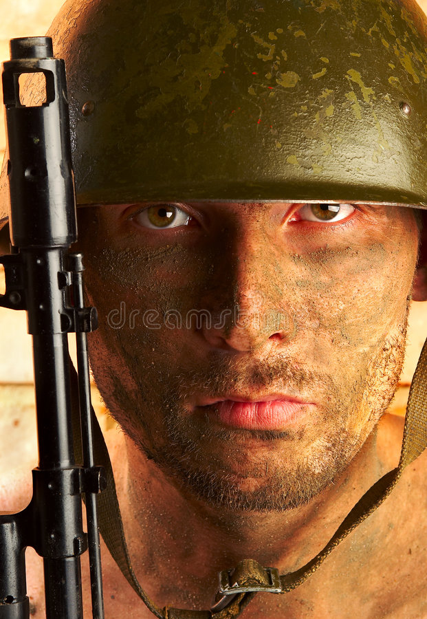 Soldier. The soldier in a military helmet royalty free stock photo
