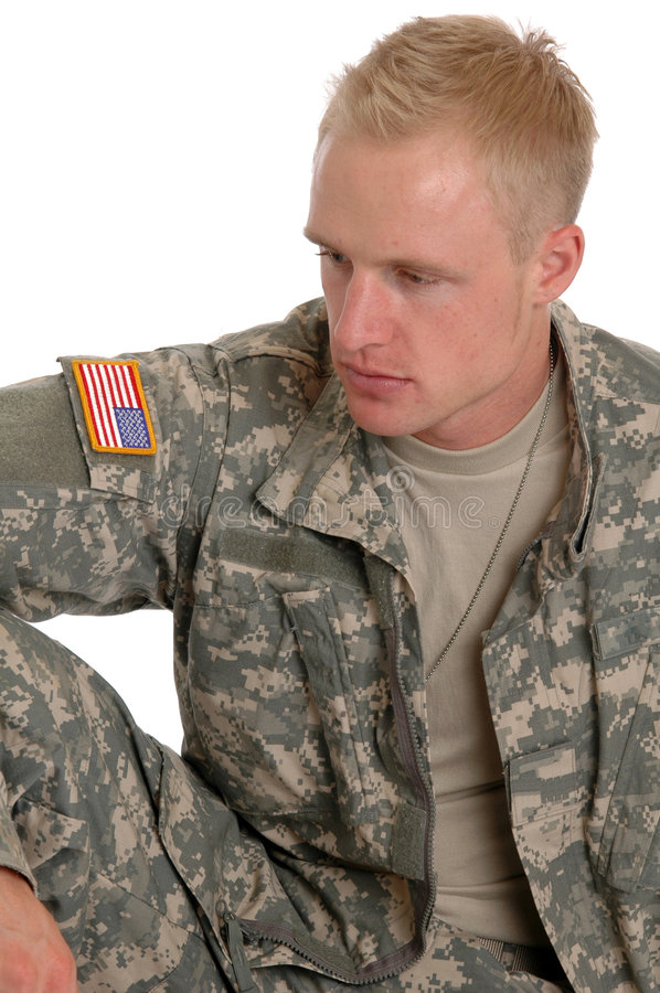 Soldier. A soldier in combat fatigues sitting on the grou8nd stock photo
