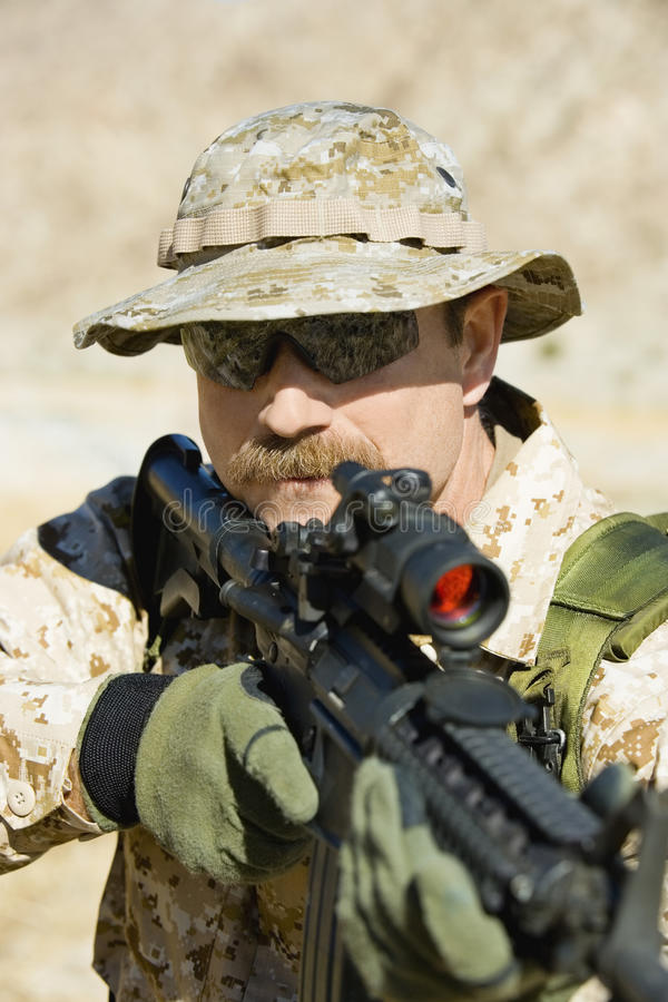 Soldier Aiming Rifle royalty free stock image