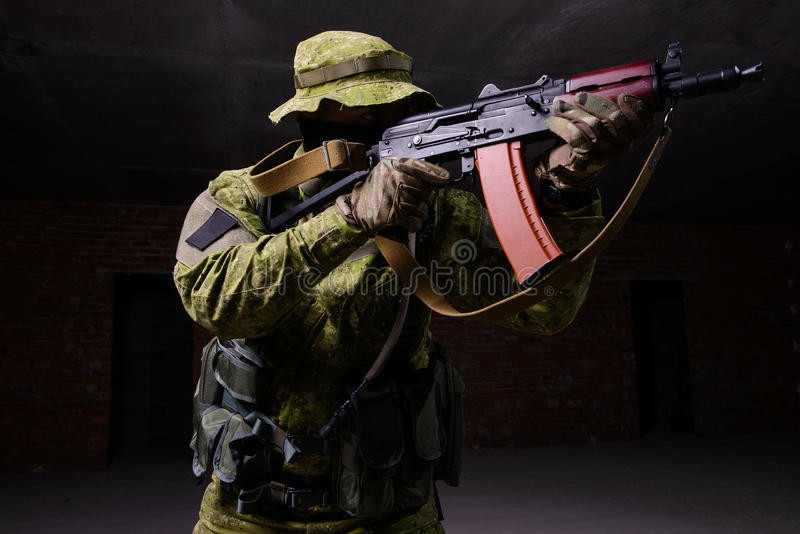 Soldier aiming from rifle stock image